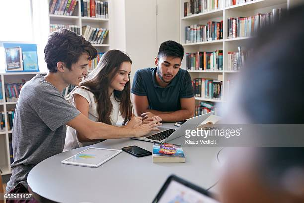 Students working in groups with laptop