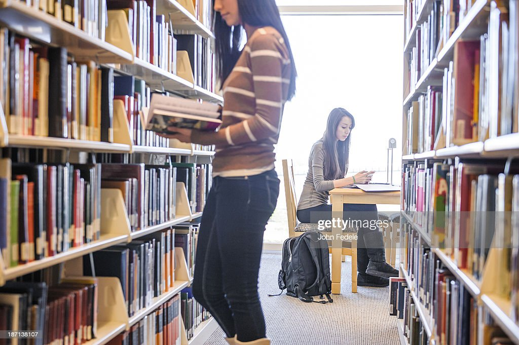 Students working in library : Stock Photo