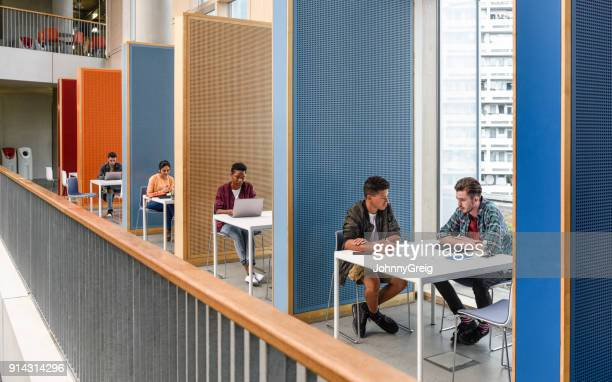 Students working in modern study cubicles at FE college