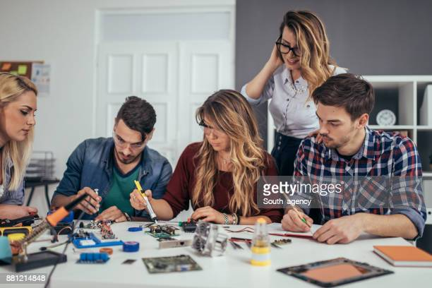 Students working on a computer part