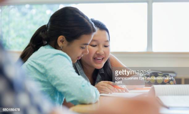 students working together in classroom - leanincollection stock pictures, royalty-free photos & images