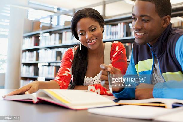 students working together in library - high school student stock pictures, royalty-free photos & images