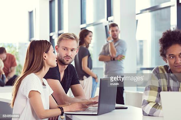 students working together on laptop at the university - izusek stock pictures, royalty-free photos & images