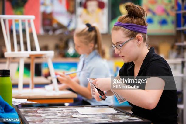 Students working using scissors in art class