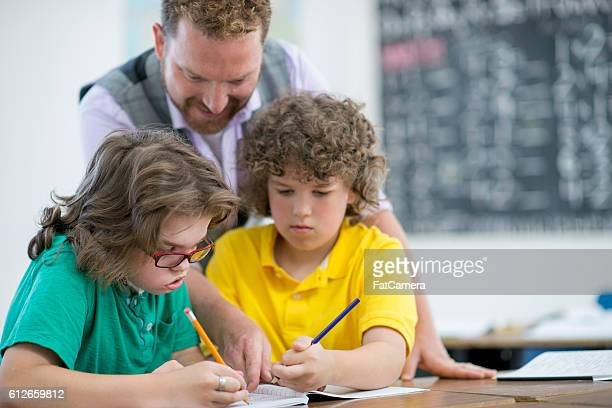 Students Working with a Tutor