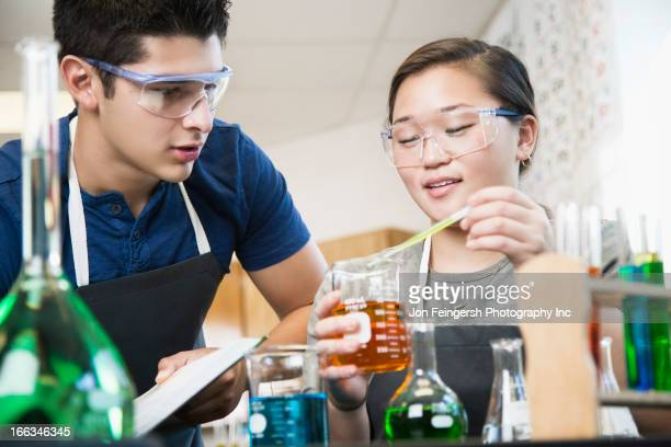 Students working with chemicals in classroom
