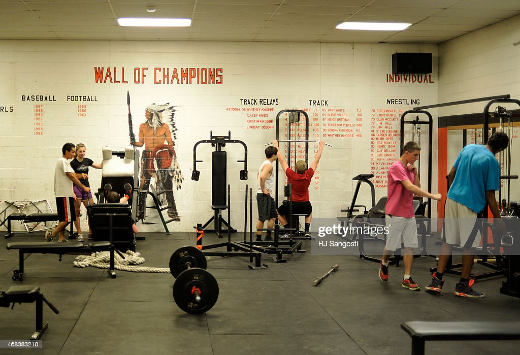 Students workout in the weight room at Lamar High School