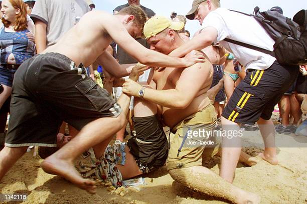 Students wrestle on the beach at South Padre Island Texas March 16 2001 during the annual rite of Spring Break Some 125000 revelers mostly college...