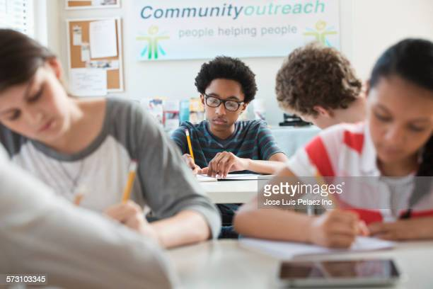 Students writing at desks in volunteer clinic