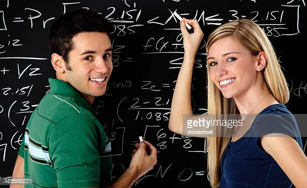 Students Writing on a Blackboard