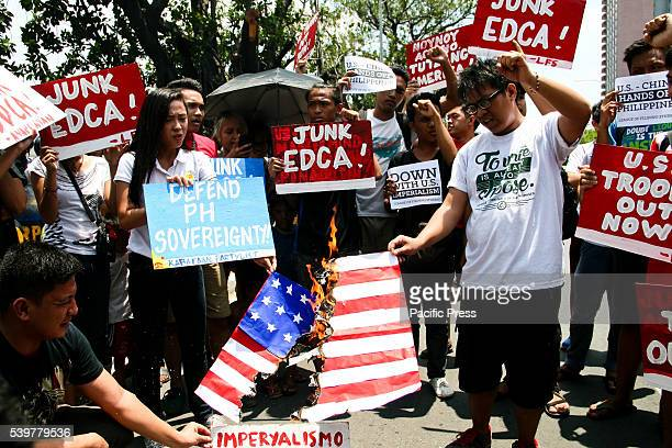 Studets burned a mock US flag in front of the US embassy League of Filipino Students members faced police officers in front of the US embassy in...