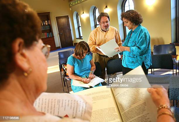 studies the program for the Saturday morning Bat Mitzvah service while Jeanette Macht Rabbi Richard I Meirowitz cq and Cantor Beth Levin do the same...