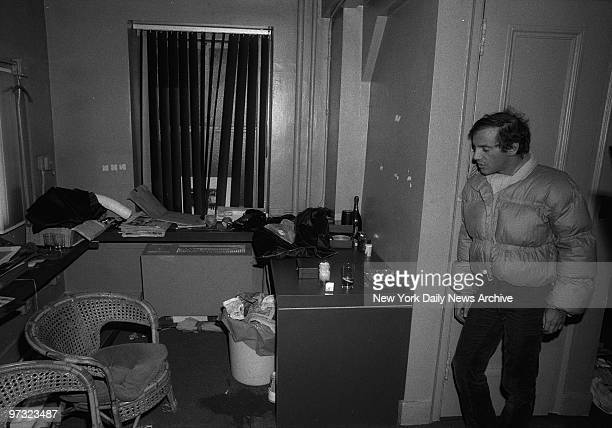 Studio 54 coowner Steve Rubell looks over mess in office after federal agents raided the disco