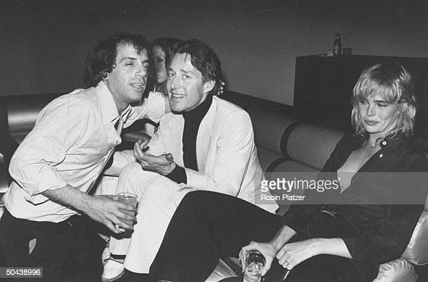 Studio 54 disco owner Steve Rubell fashion designer Halston and model/actress Margaux Hemingway sitting in the Mike Todd Room w drinks in hand at...