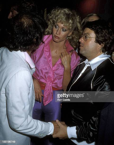 Studio 54 owner Steve Rubell singer Olivia NewtonJohn and producer Allan Carr attend the 'Grease' Premiere Party on June 13 1978 at Studio 54 in New...