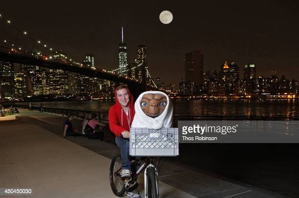 Studio artist rides ET figure to its new home in the film experience at Madame Tussauds New York for the anniversary of Universal Studios/Amblin...