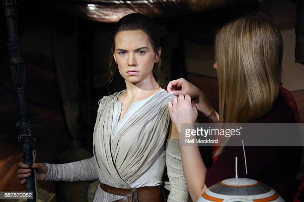 Studio Artist Vanessa Sallinger working on Daisy Ridley's wax figure character Rey from Star Wars The Force Awakens is unveiled at Madame Tussauds on...