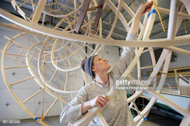 Studio assistant Elizabeth Kleene takes down a portion of Aaron T Stephan's wooden sculpture Paths Woven Stephan's Portland studio Wednesday February...