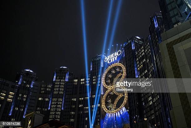 Studio City casino resort developed by Melco Crown Entertainment Ltd stands illuminated at night in Macau China on Tuesday Feb 16 2016 Mainland...