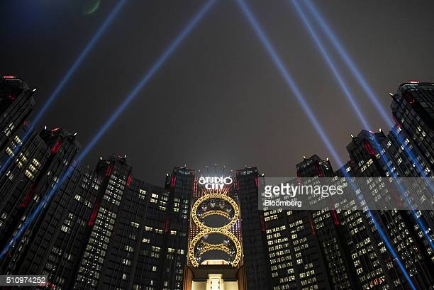Studio City casino resort, developed by Melco Crown Entertainment Ltd., stands illuminated at night in Macau, China, on Tuesday, Feb. 16, 2016....