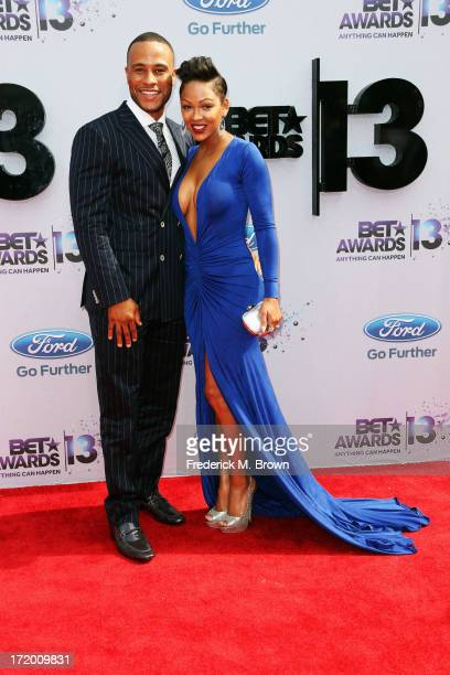 Studio executieve DeVon Franklin and actress Meagan Good attend the 2013 BET Awards at Nokia Theatre LA Live on June 30 2013 in Los Angeles California