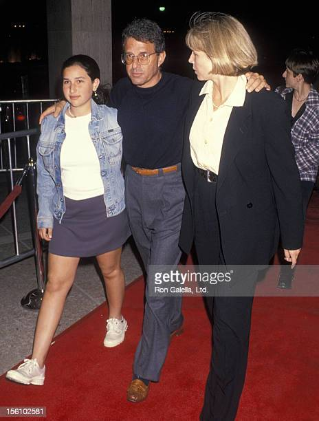 Studio executive Ron Meyer wife and daughter attending the screening of 'The Paper' on March 16 1994 at the Cineplex Odeon Cinema in Century City...