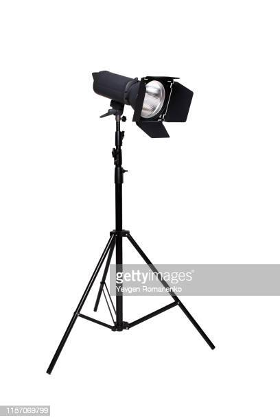 studio flash light on a tripod stand isolated on white background - ディスコ照明 ストックフォトと画像