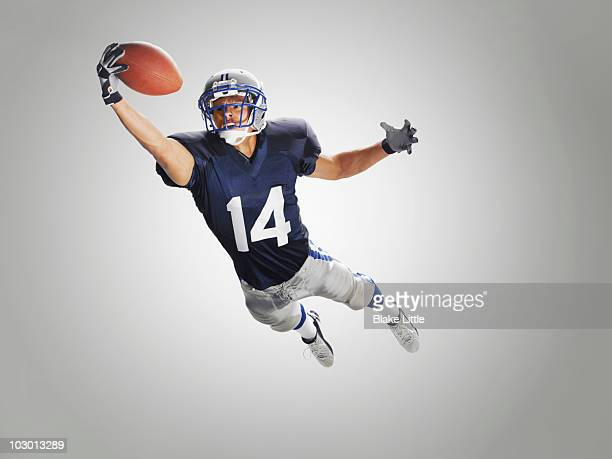 studio football player - american football player stock pictures, royalty-free photos & images