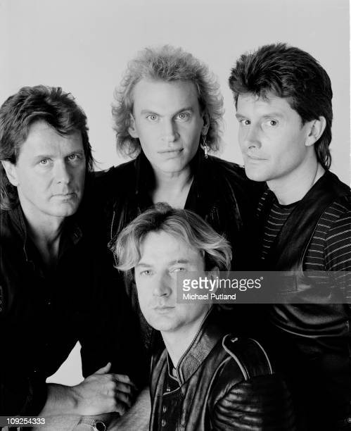 Studio group portrait of progressive rock band Asia London 1990 John Wetton Geoffrey Downes Carl Palmer