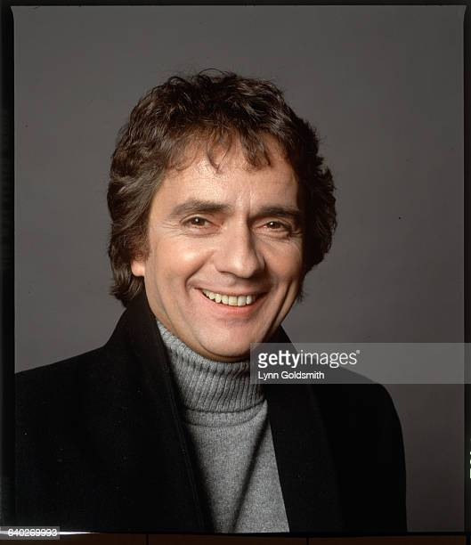 Studio headshot of actor Dudley Moore He is shown smiling wearing a turtleneck sweater Undated photograph