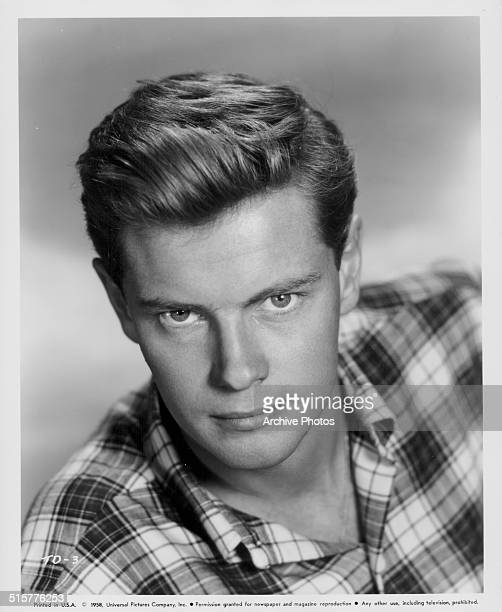 Studio headshot of actor Troy Donahue wearing a check shirt 1958