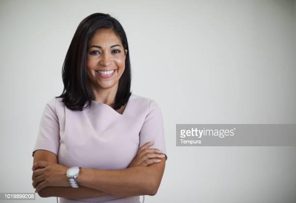 studio headshot of beautiful brazilian woman. - brazilian ethnicity stock pictures, royalty-free photos & images