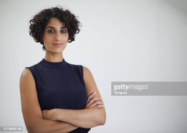 studio headshot of confident businesswoman looking at camera. - middle eastern ethnicity stock pictures, royalty-free photos & images