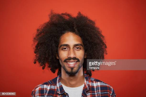 Studio headshot of young trendy spanish man.