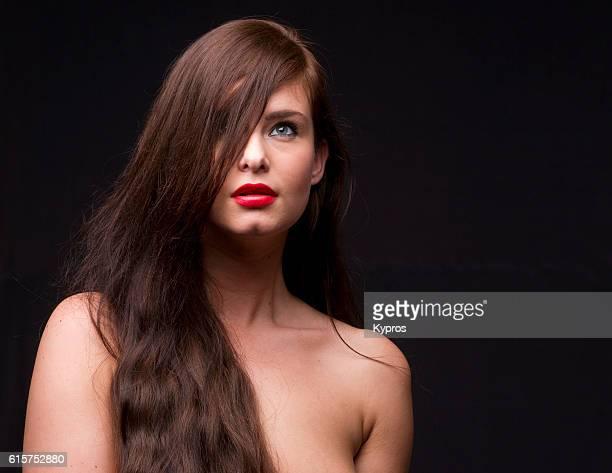 Studio Headshot Of Young Woman