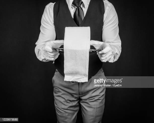 studio image of butler holding roll of toilet paper on silver tray - eyeem jeremy walter stock pictures, royalty-free photos & images