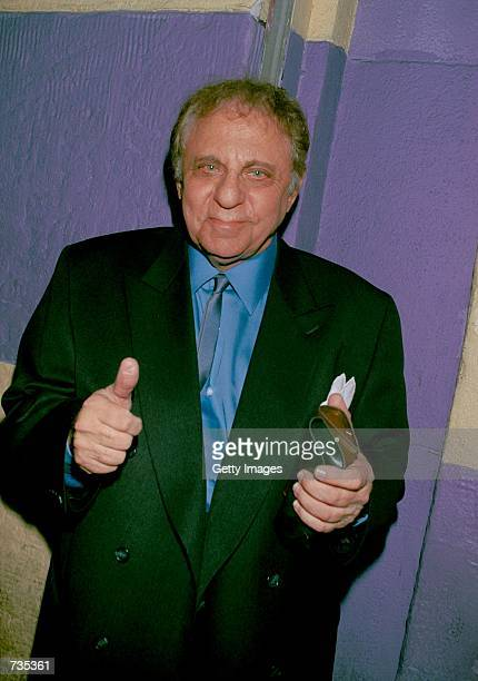 Studio musician/drummer Hal Blaine gives a thumbs up outside The Whiskey A GoGo where singer Nancy Sinatra performed December 29 2000 in Hollywood CA