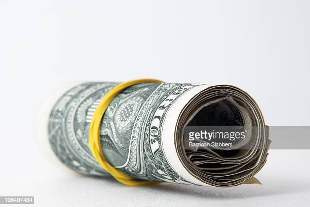 studio objects; bundle of dollars - basslabbers, bastiaan slabbers stock pictures, royalty-free photos & images