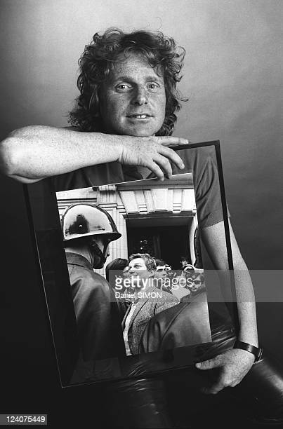 Studio of Daniel Cohn Bendit in France on June 07 1986 Daniel Cohn Bendit showing a picture of him during French May Events of 1968 taken by late...