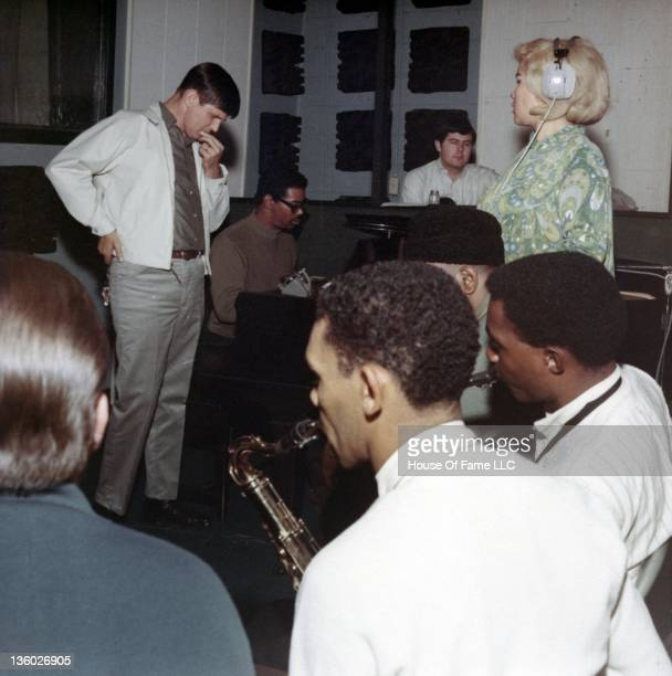 Studio owner Rick Hall Marvell Thomas David Hood and R and B singer Etta James recording at Fame Studios circa 1967 in Muscle Shoals Alabama