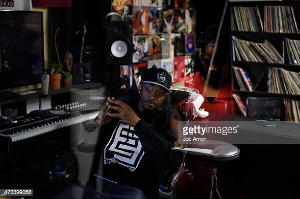Studio owner Xavier Davis listens and watches Denise Hysaw sing while laying down tracks for a video Willie Mosley is recording at dia Studios to be...