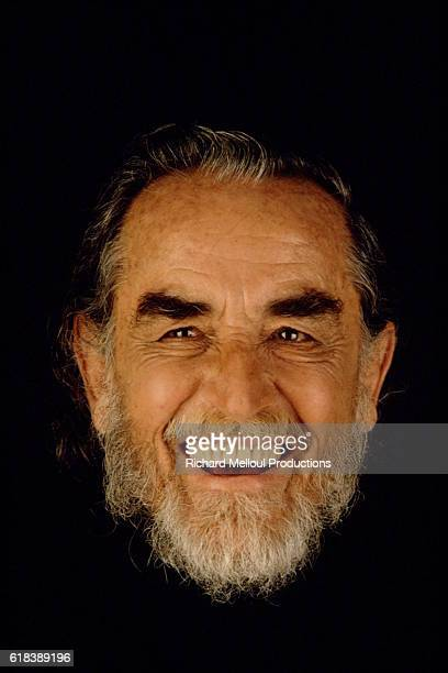 Studio photo of Vittorio Gassman smiling.