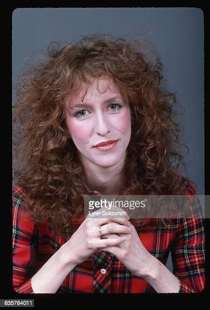 Studio photograph of comedienne Laraine Newman She wears red plaid shirt