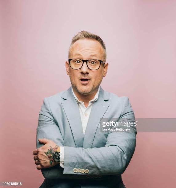 studio photograph of middle-aged businessman - überraschung stock-fotos und bilder