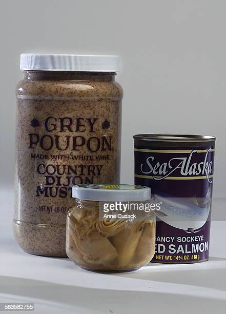 studio photos of items from the 99 cents store Grey Poupon artichokes and red salmon