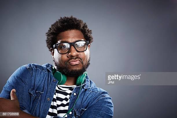 Studio portrait mid adult man posing with headphones