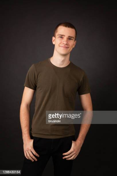 studio portrait of 18 year old man - khaki green stock pictures, royalty-free photos & images