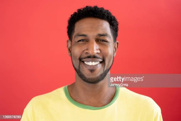 studio portrait of 44 year old mixed race man in t-shirt - indian ethnicity stock pictures, royalty-free photos & images