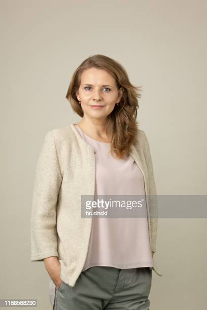 studio portrait of a 45 year old woman - 45 49 years stock pictures, royalty-free photos & images