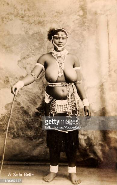 A studio portrait of a barebreasted Zulu girl in her native dress and jewellery in Cape Town on the 15th December 1925